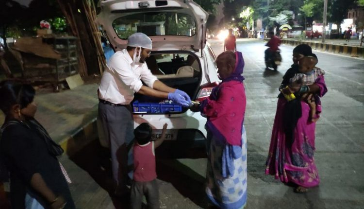 TML distributing cooked meal during dinner time